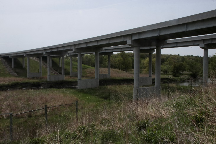 Text Box: Figure 1: One of two wildlife underpasses that the Iowa DOT constructed along Highway 20. This one crosses the valley of the North Raccoon River; the other, the Iowa River.